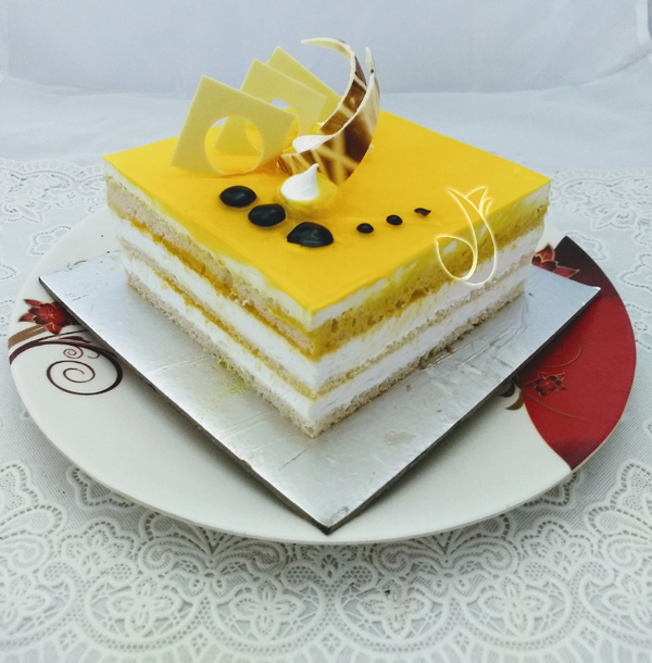 send flower Paryavaran Complex DelhiPineapple Square Cake (Less Creamy)