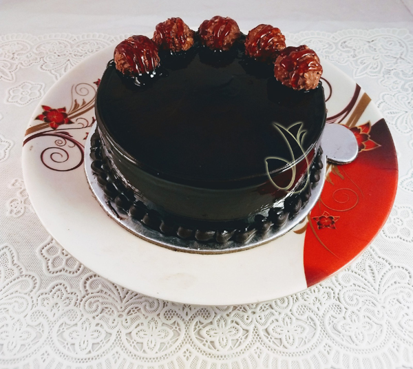 send flower Bhajan Pura DelhiFerrero Rocher Chocolate Cake