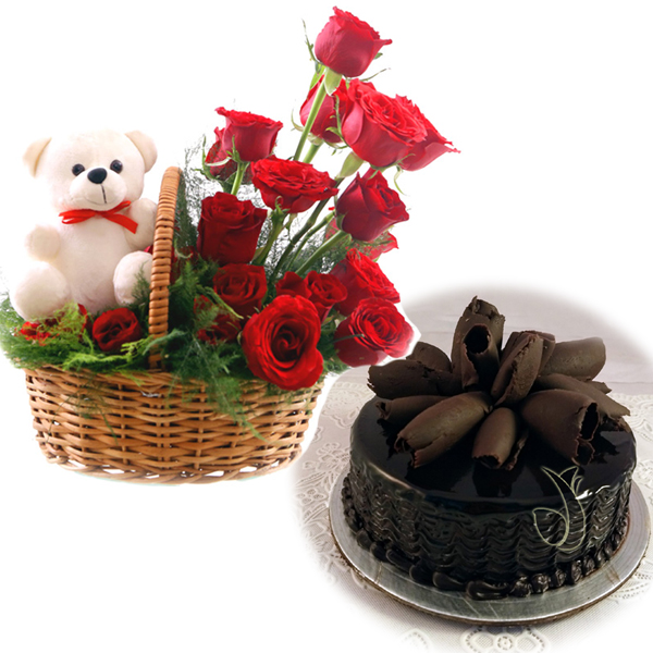 send flower Paryavaran Complex DelhiRose Basket & Chocolate Roll Cake