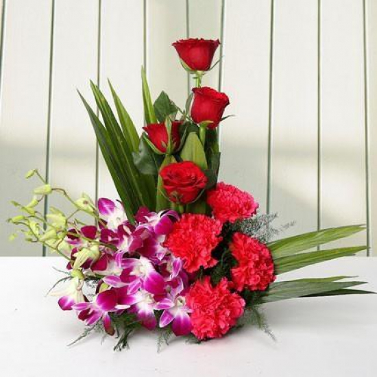 send flower Anand Niketan DelhiCute Arrangement Carnations N Orchids