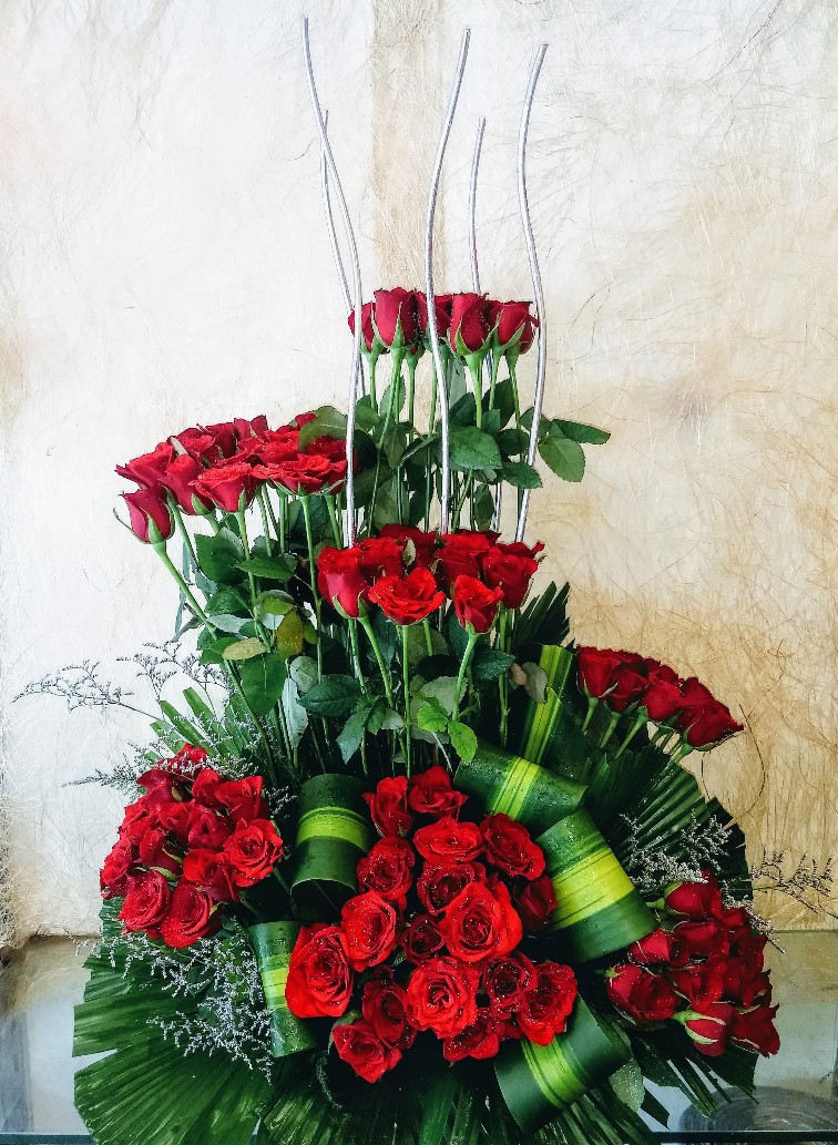 send flower Sadiq Nagar DelhiArrangement of 50 Red Roses
