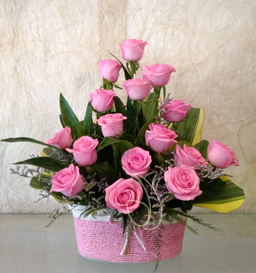 Flowers Delivery to Sector 77 Noida20 Pink Rose in Rafia Basket
