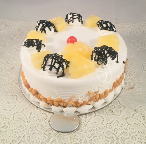 send flower Sadiq Nagar DelhiRound Pineapple Cake