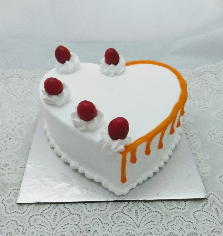 send flower Alaknanda DelhiButter Scotch Heart Shape Cake