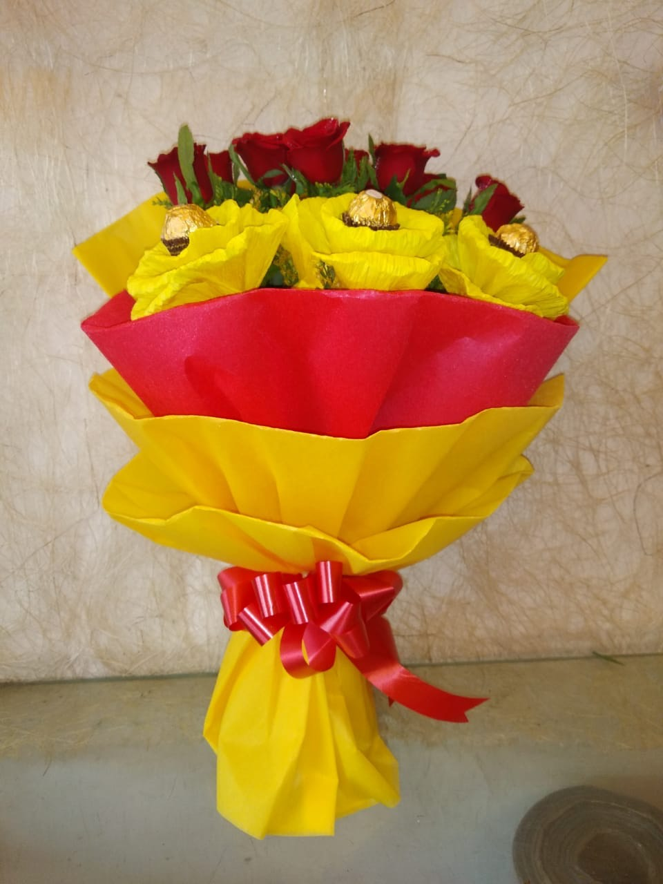 Flowers Delivery in Uniworld City GurgaonRed Roses Ferrero Rocher Bunch