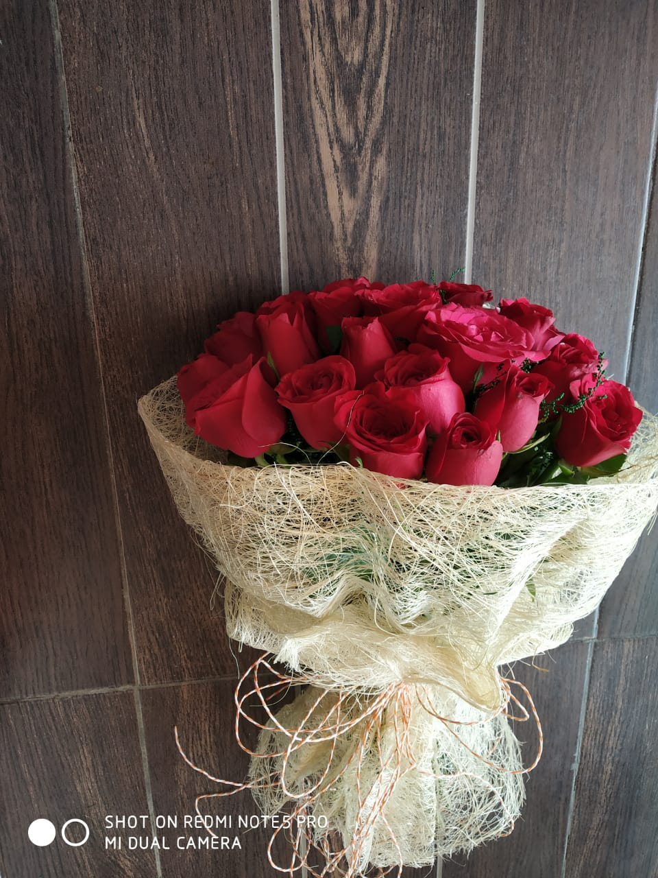 send flower Bhajan Pura DelhiRed Roses in Jute