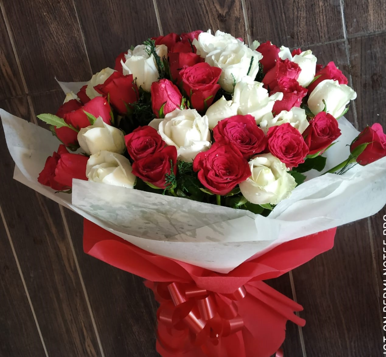 send flower Bhajan Pura DelhiRed & White Roses in Duble Layer Packing