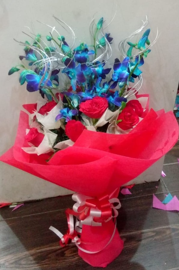 Flowers Delivery to Sector 77 NoidaRed Roses & Blue Orchid in Paper Wrapping