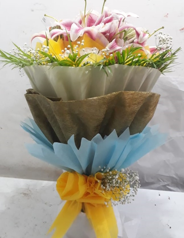send flower Saket DelhiBunch of 8 Pink Oriental Lillys in 3 Layer Packing