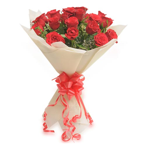 send flower Bhajan Pura DelhiBunch of 20 Red Roses in Paper Packing