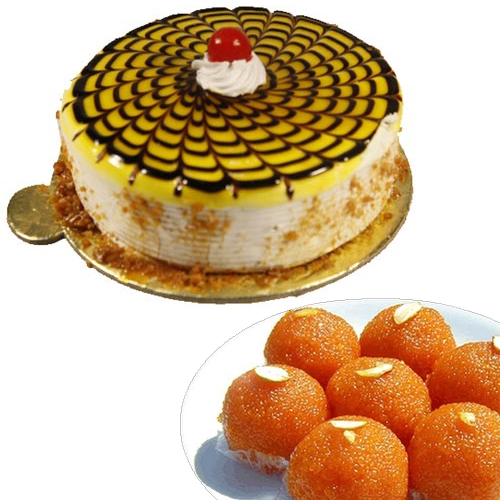send flower Defence Colony Delhi1/2KG Butter Scotch Cake & 500Gm Moti Choor Ladoo