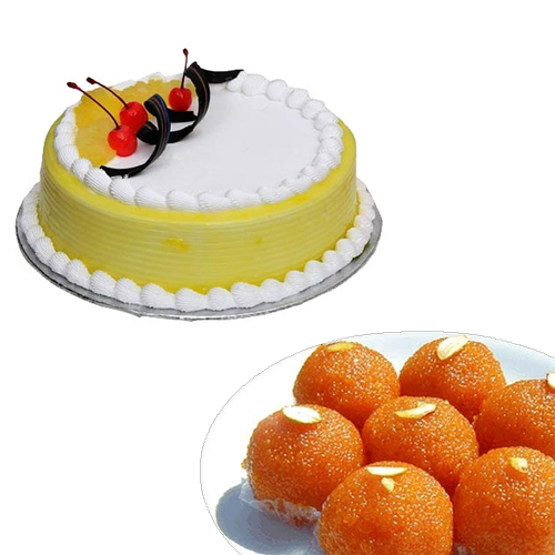 Cake Delivery in DLF Phase 1 Gurgaon1/2Kg Pineapple Cake & 1/2Kg Motichoor Ladoo