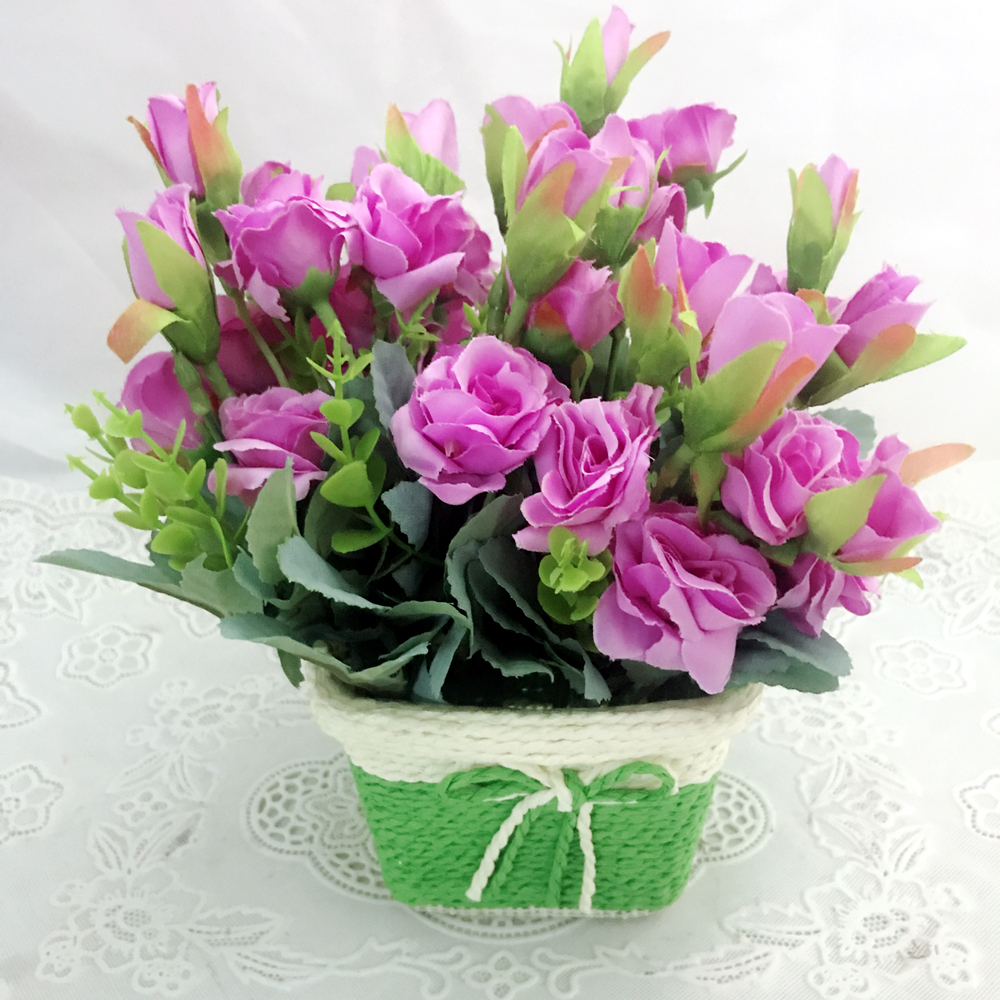 send flower Defence Colony DelhiArtificial Purple Mini Roses Buds in Unbreakable Pot (Only For Delhi)