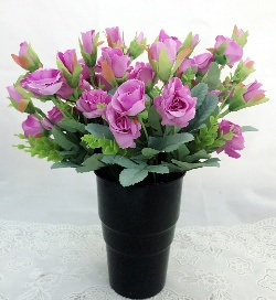 send flower Seelampur DelhiArtificial Purple Mini Roses in a Black Plastic Vase (Only For Delhi)