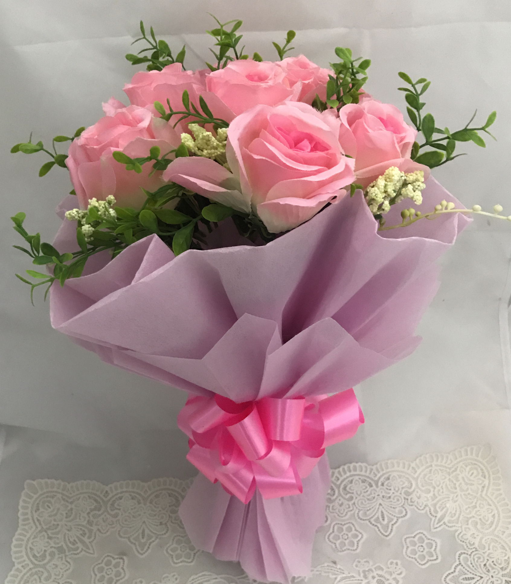 send flower Karam Pura DelhiArtificial 8 Pink Roses Hand Bouquet (Only For Delhi)