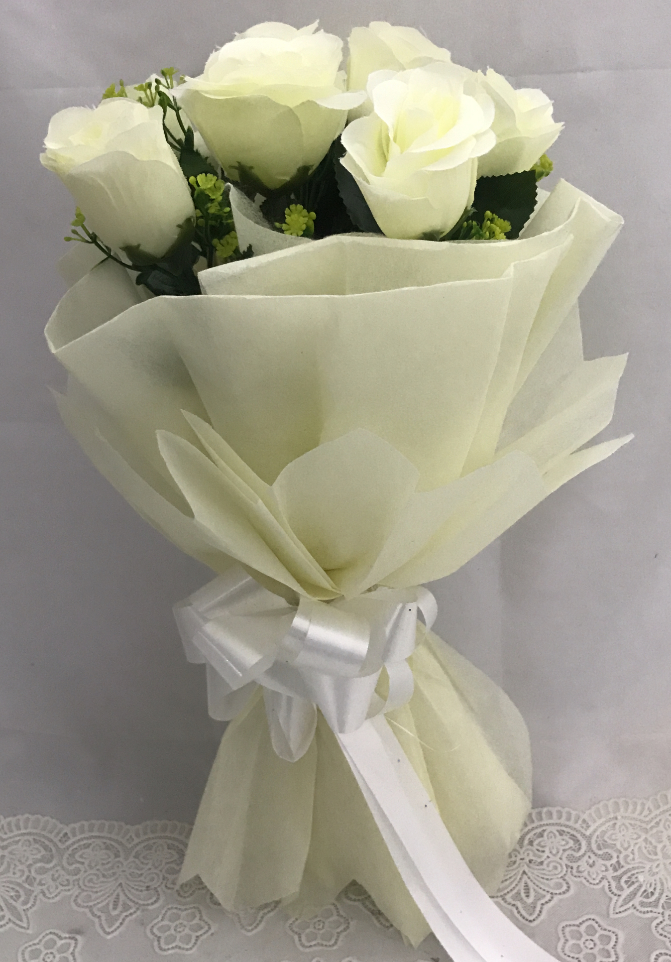 send flower Bhajan Pura DelhiArtificial 8 White Roses Hand Bouquet (Only For Delhi)