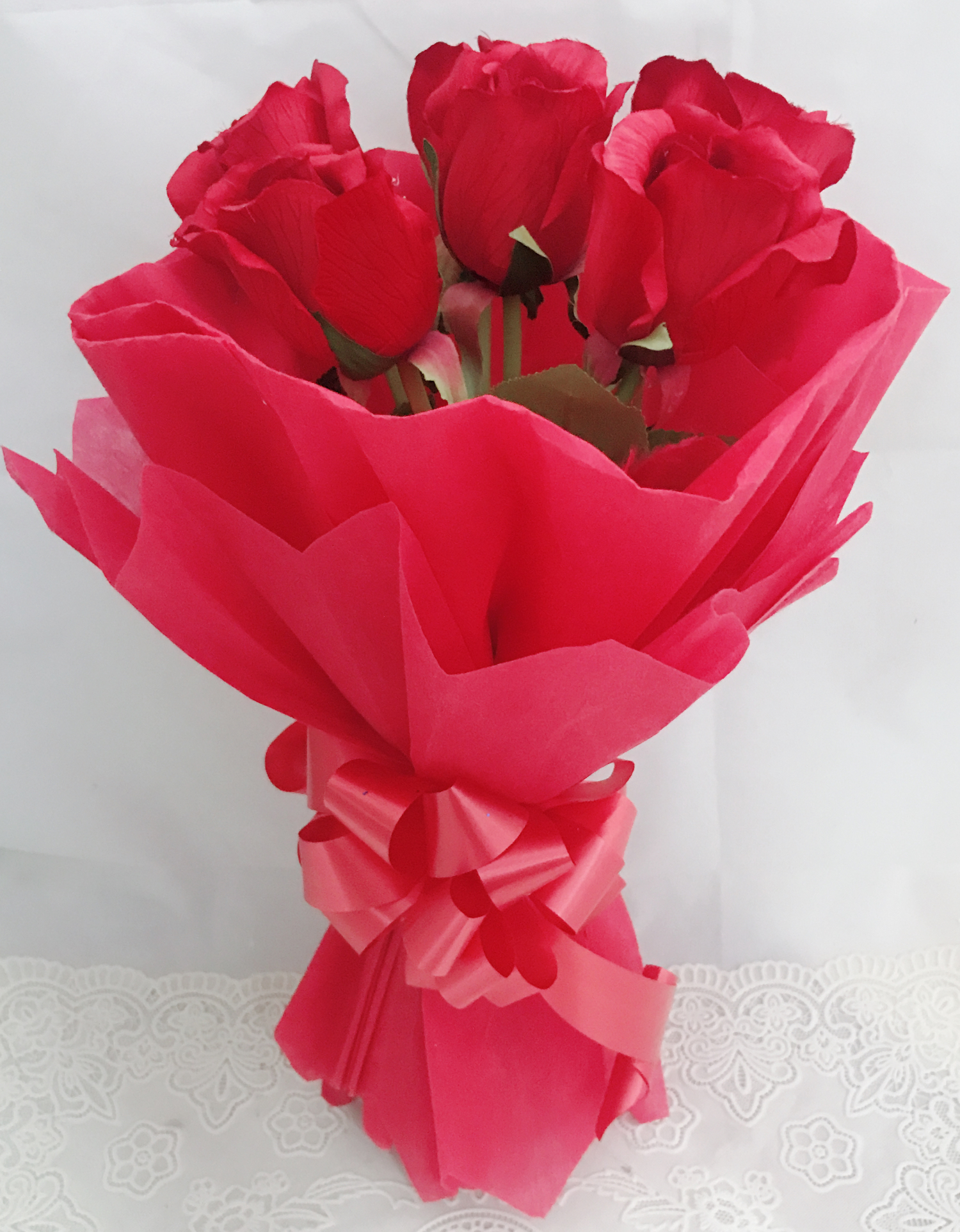 send flower Defence Colony DelhiArtificial 6 Red Roses Hand Bouquet (Only For Delhi)