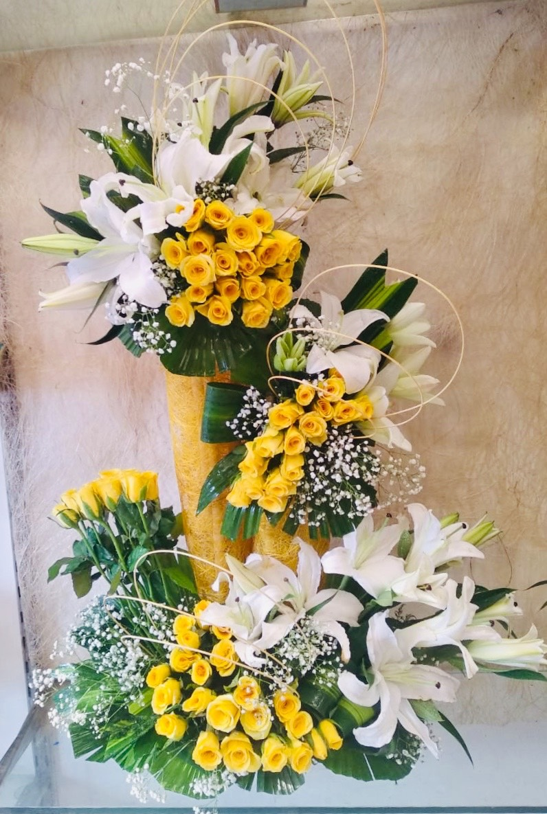 send flower Vasant viharBig Arrangement of 100 Yellow Roses & 10 White Lilys with Some Drysticks