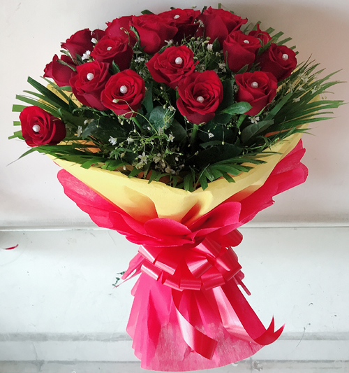 send flower Vasant viharBunch of 30 Red Rose in Red & Yellow Paper Packing