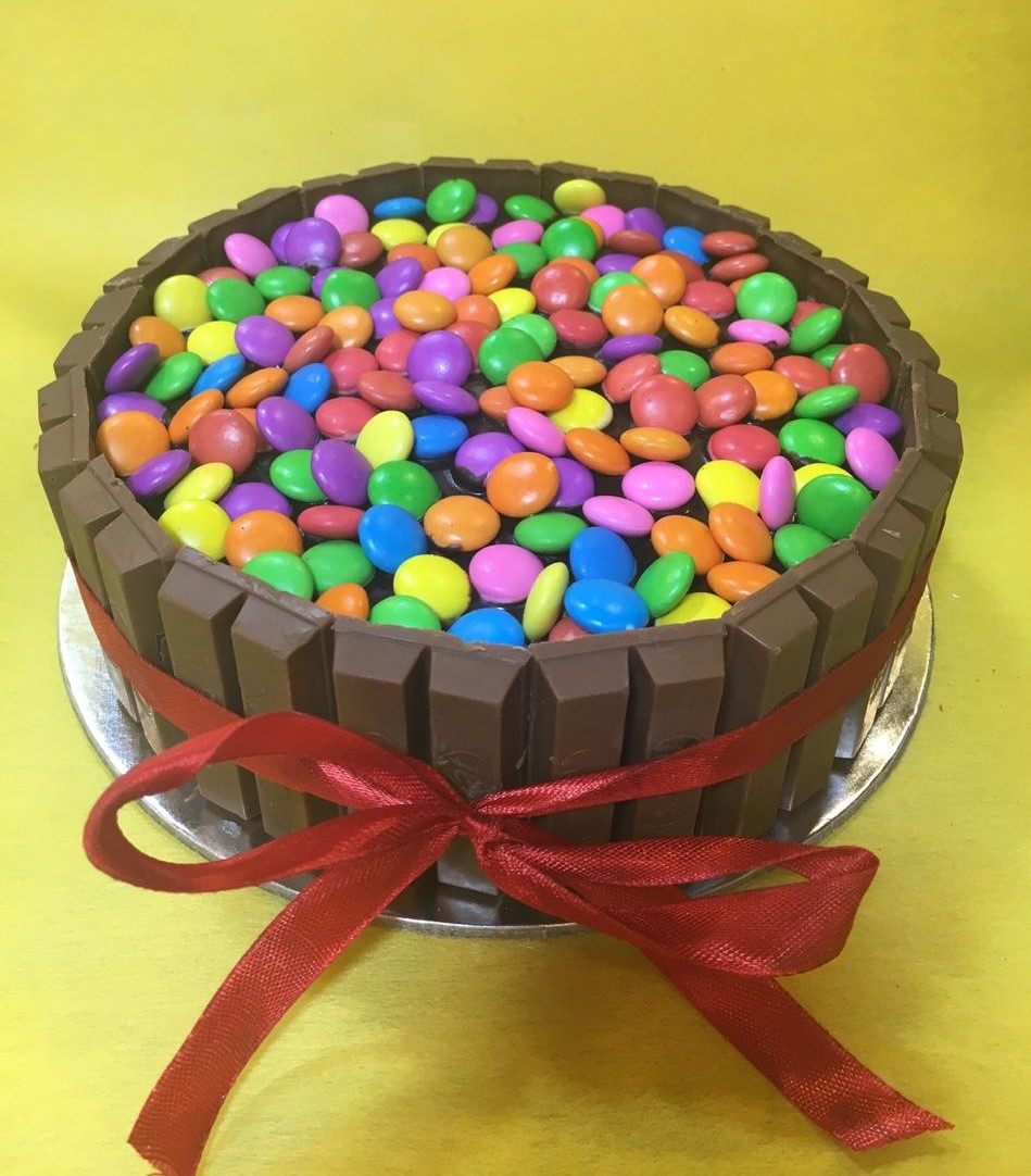 send flower Ashram Delhi1Kg Kitkat Gems Cake