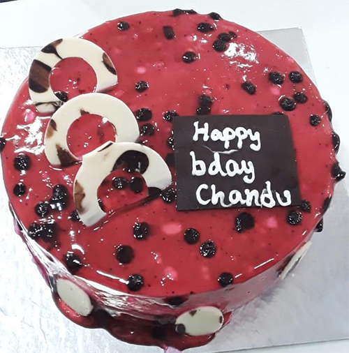 send flower Karam Pura DelhiExotic Blueberry Cake
