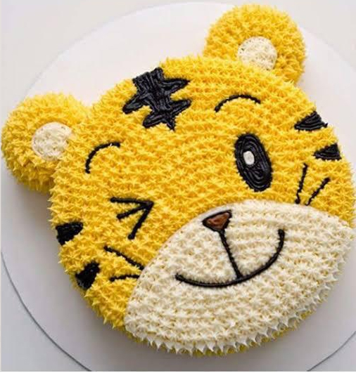 send flower Saket Delhi1.5 KG Cat Face Cake