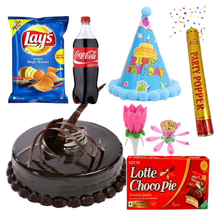 send flower Seelampur DelhiBirthday Treat - Cake, Party Popper, Lotus Candle, Cap, Chips and Coca Cola